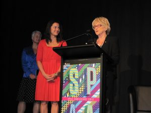 Natalie Miller presents the inaugural award to Rachel Okine